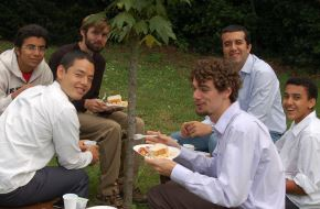 men eating together