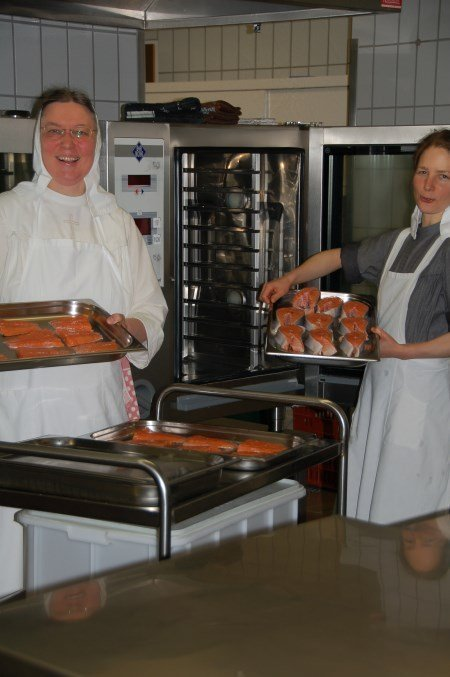 Sisters in kitchen with donated fish