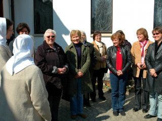 Little group of women with sisters in front of the motherhouse-chapel