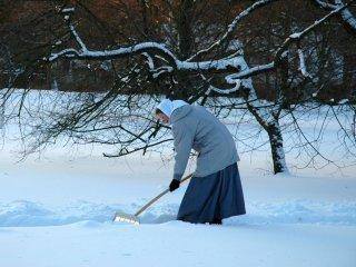 Sister shovelling snow
