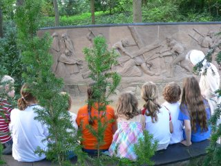 Children looking at a relief at the garden of Jesus' suffering