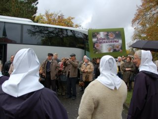 Saying goodbye to a group of visitors at the bus