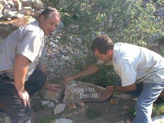 Placing a rock of blessing in Israel prayer garden