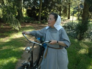 Sister with bicyle at garden work